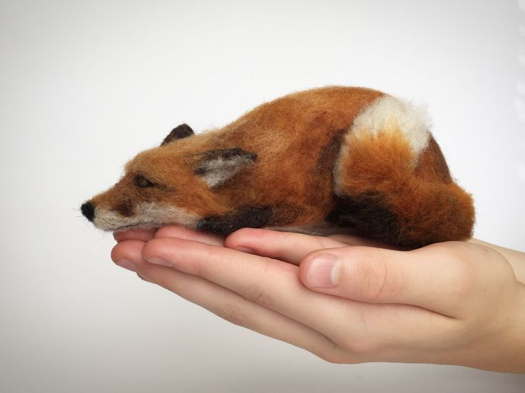 Needle felted fox sculpture.