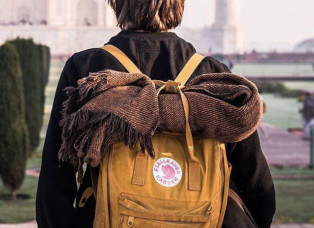 Kånken packpack in warm yellow.