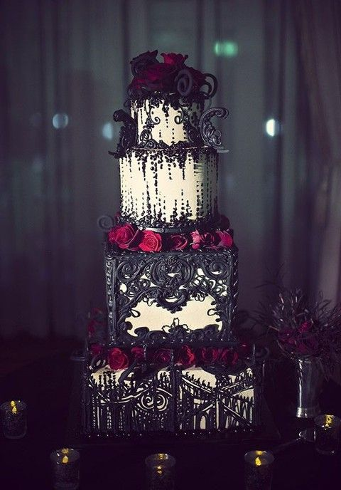 Unique 4 tier Halloween inspired wedding cake with incredibly detailed red and black themed decoration