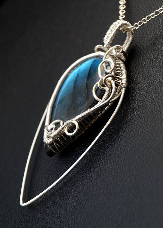 A delicate, unique, handmade, wire wrapped pendant with Labradorite.  Pendant was designed and made by Me, using an extremely labor-intensive and precise wire-wrapping technique, with silver 925, 930 and 999.  Dimensions of pendant: length: 5.7 cm (2.24 inch) width: 2.6 cm (1.02 inch)