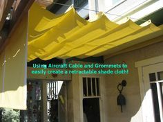 DIY SIMPLE RETRACTABLE SHADE CLOTH! Use a wire cable set, place grommets where you want the peaks, and slide thru the cable!