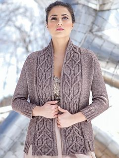 Fascinating cables twist along the neckline of this top-down open cardigan with raglan sleeves.