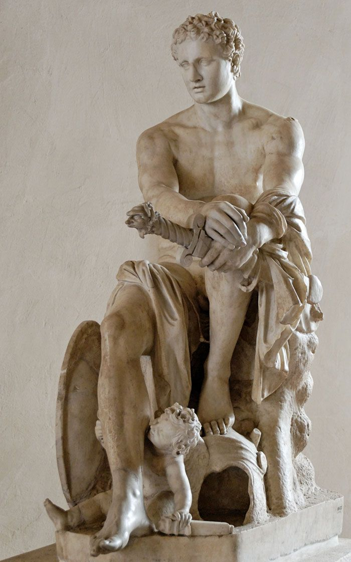 "This Roman statue of Mars is unusual. The god of war is sculpted seated, without armor, and he's holding the sword still in its scabbard as if he is resting after a battle. In addition, the helmet is at his feet and the shield is placed on his right side. So this marble shows a ""humanized"" god of war. Museo Nazionale Romano, Rome."