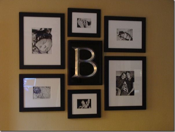 Gallery Wall Photo Display Arrangement With Family Name In