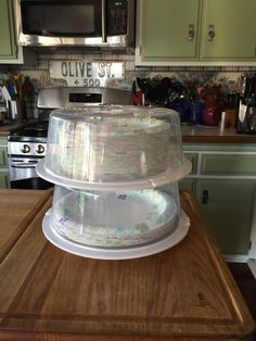"Dollar Tree cake covers to store paper plates. I have one for my 10"" plates and one for the 9"" plates. Keeps them clean when stored in the garage. No more wrestling with that huge plastic bag they come in from Sam's or Costco when I need to replenish my kitchen supply."