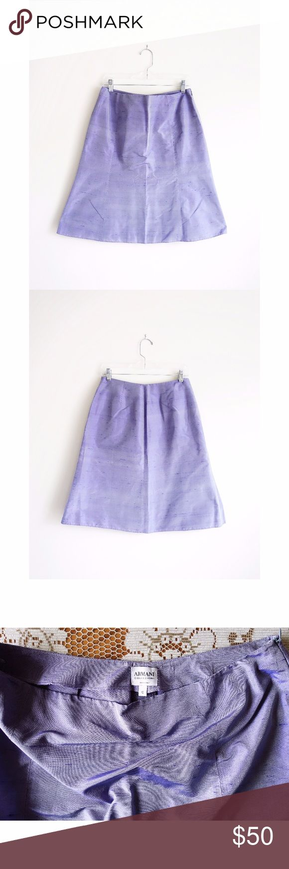 "Armani Collezioni Lavender Silk Skirt IT 48 US 12 Armani Collezioni Lavender Silk Skirt size IT 48 US 12, gently used--no rips, stains, or holes, made in Italy, hidden side zip with hook and eye closure, A-line or very subtle trumpet silhouette that flares out slightly at hem, unlined, 100% dupioni or shantung silk in a light purple lavender with characteristic slugs and crosswise ribs/streaks of hyperpigmented threads that intentionally look like pulls, 15"" across waist, 21"" across hips 8""…"