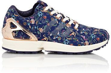 """adidas x Limited Edt Night Sky (navy) and multicolored floral-print nylon ZX Flux low-top sneakers detailed with coppertone accents. A collaboration between adidas Consortium and Limited Edt Torsion® System provides protection, support and stability to the midfoot 1.25""""/30mm midsole (approximately) Rounded toe, translucent signature tri-stripe appliqué at quarter panels, logo tab at padded tongue, padded collar, molded heel caged, injected EVA midsole, off-whi"""