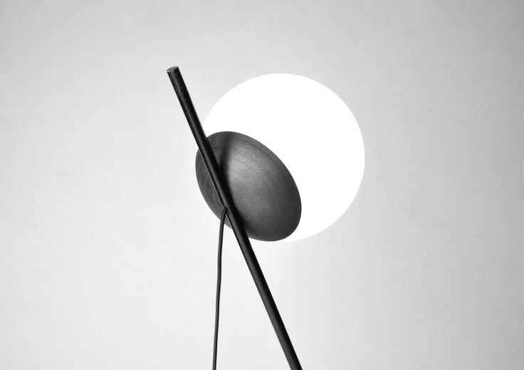 Minimal, slim and iconic, Leela is a floor lamp composed by a powder coated steel tripod and a spherical head.