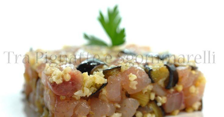 Crudo di ricciola, con melanzane saltate e miglio, con olio alla bottarga, limone e aglio