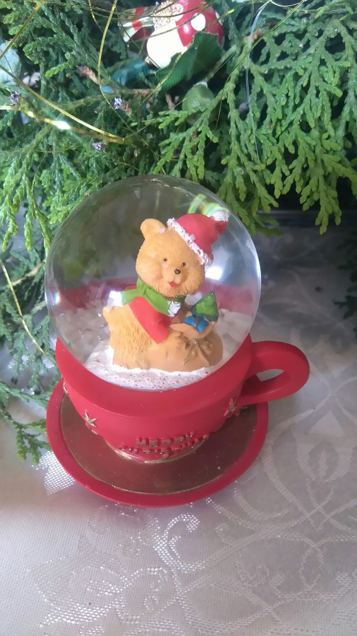 Snow globe with in teacup with bear