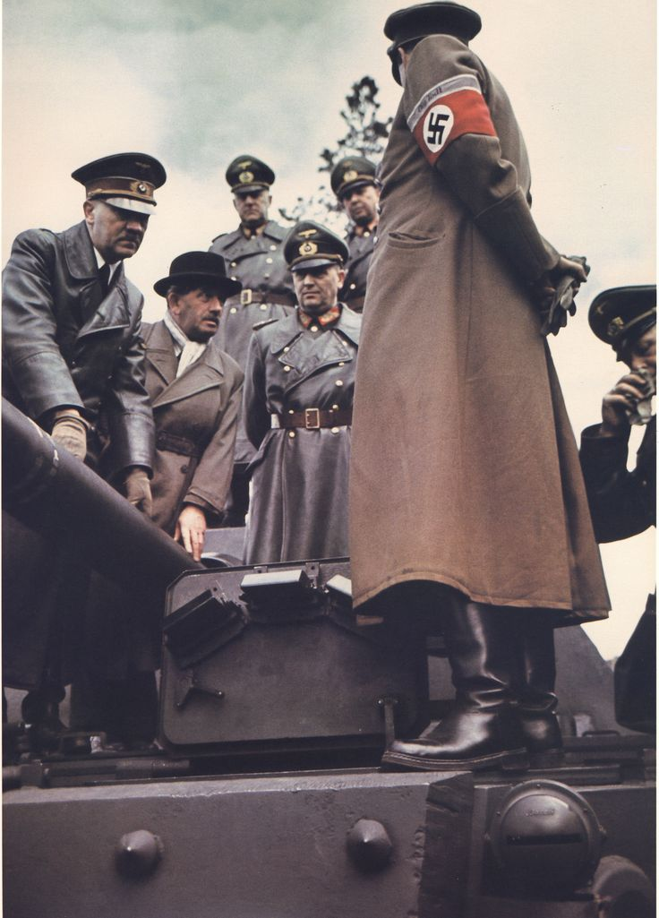"""Hitler with Waffen-SS Oberführer Ferdinand Porsche. His Tiger tanks were that time's most capable and powerful tanks. Dr Porsche also created the Mercedes-Benz SS/SSK, Hitler's Volkswagen """"People Car"""" and the first gasoline-electric hybrid (in 1898!). He was awarded the War Merit Cross. After Germany's defeat, having used slave labour, including Jews from concentration camps, he was arrested for war crimes, though no charges were filed. After some months, he was released."""