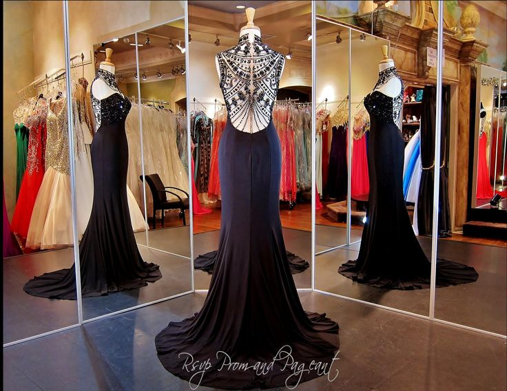 Black Red Carpet Gown to Die For! ONLY at Rsvp Prom and Pageant, Atlanta, GA. Any black tie event will do for this classy and sophisticated evening gown. The illusion bodice has a high neckline and sweetheart lining and high Slit. Jersey material to show of your curves! The Detailed Beading on the Illusion Back is out of this world! Buy it HERE at http://rsvppromandpageant.net/collections/long-gowns/products/black-red-carpet-gown-illusion-back-115ec0151340572