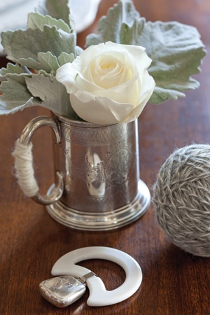 Little Lamb Baby Shower | Dress the table with antique rattles, teething toys, and baby cups