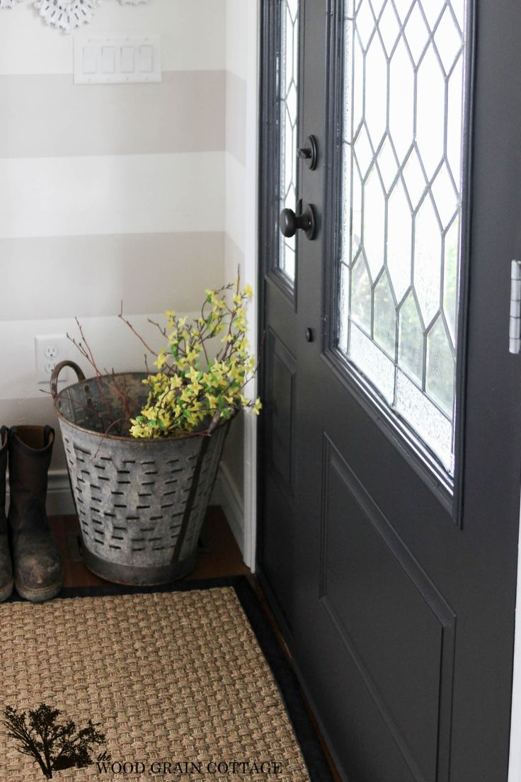 Front door painted with Onyx by Benjamin Moore®, satin finish and Oil Rubbed Bronze Hardware