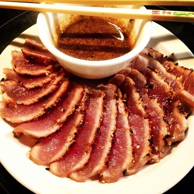 Paleo clean eating healthy meal. Seared sashimi grade tuna with a ginger/sesame crust. Wasabi soy dipping sauce.