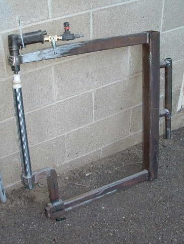 """Pneumatic Planishing Hammer by Ian Griffith -- Homemade pneumatic planishing hammer fabricated from steel square tubing and mild steel. Powered by a repurposed rivet gun, the unit features a 24"""" throat. http://www.homemadetools.net/homemade-pneumatic-planishing-hammer-3"""