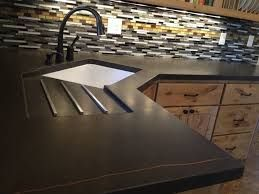 Image result for light wood kitchen cabinet black cement countertops