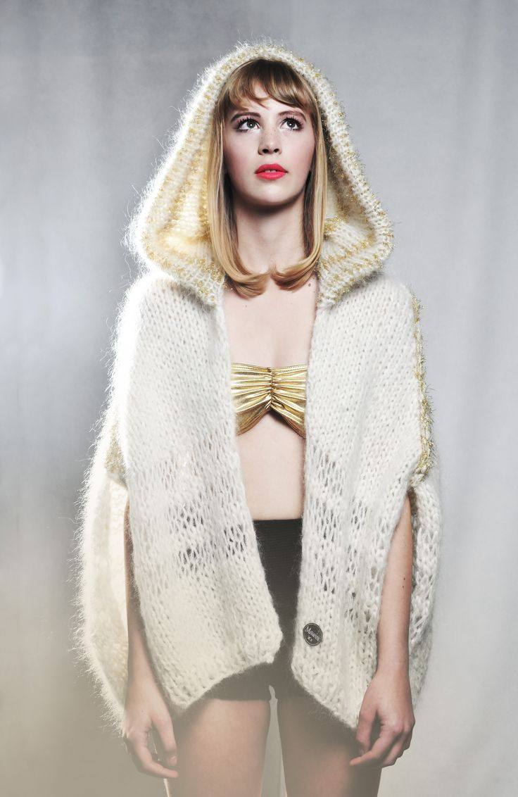 Hand knitted cape with hoodie.  Off white and gold.  Big knits from the handmade knitwear label Maurice. The models are all Mauricettes. (Barista from the Maurice coffee bar)  We ship worldwide.