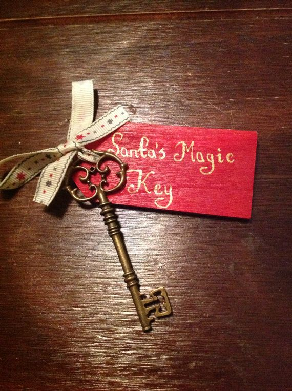 A special santa key for all those families without chimneys! A magical addition to the festive season.  This is metal key measuring 8.2cms with a painted wooden tag attached and tied with festive ribbon. The tag can be personalised on the reverse with your family name or childs name.  The ribbon may differ from that in the picture.