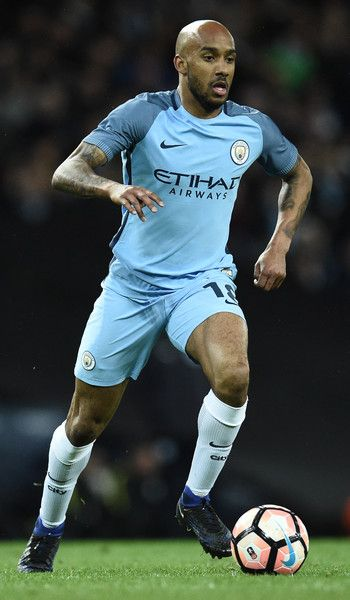 Manchester City's English midfielder Fabian Delph runs with the ball during the FA Cup fourth round replay football match between Manchester City and Huddersfield Town at the Etihad Stadium in Manchester, north west England, on March 1, 2017. / AFP PHOTO / Oli SCARFF / RESTRICTED TO EDITORIAL USE. No use with unauthorized audio, video, data, fixture lists, club/league logos or 'live' services. Online in-match use limited to 75 images, no video emulation. No use in betting, games or single…