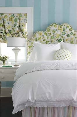 What else could a girl want beyond a fabulous fabric headboard and striped walls? Answer: nothing.