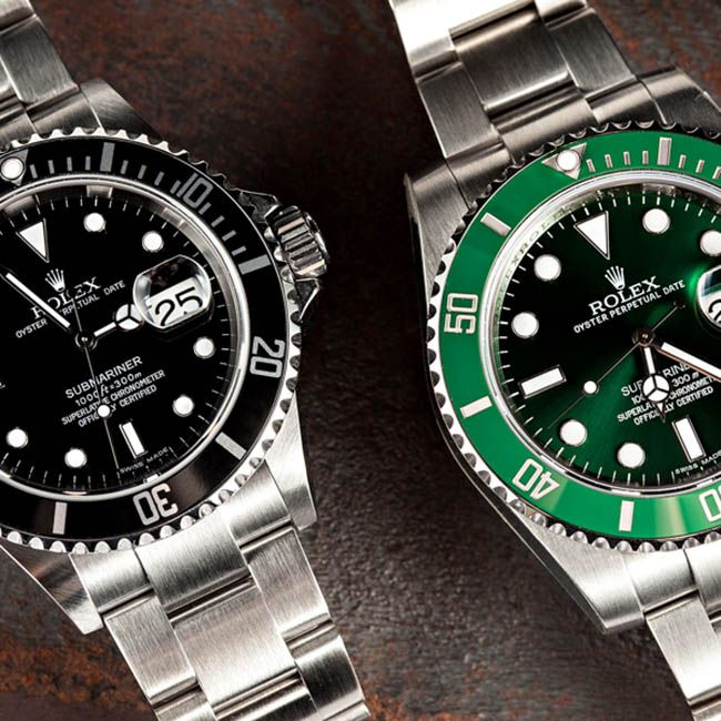A Pair of Black & Green Rolex Submariner Watches in Stainless Steel.