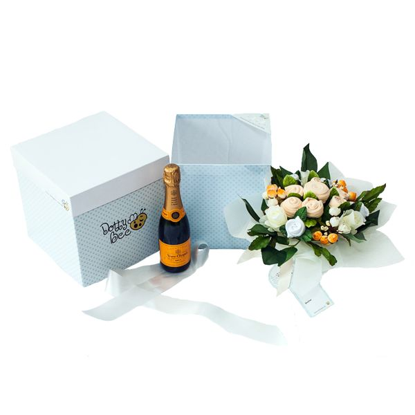 You can now add a bottle of Veuve Clicquot to your favourite colour baby clothes bouquet to be sent with your gift! Plus it's free delivery!