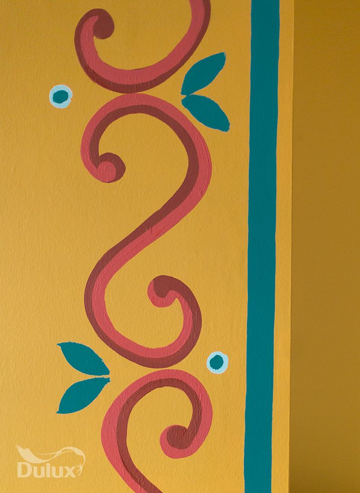 Don't be afraid to use bright, freehand patterns on your wall.