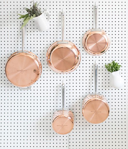 martha stewart copper pots and pans hung on white kitchen pegboard / sfgirlbybay
