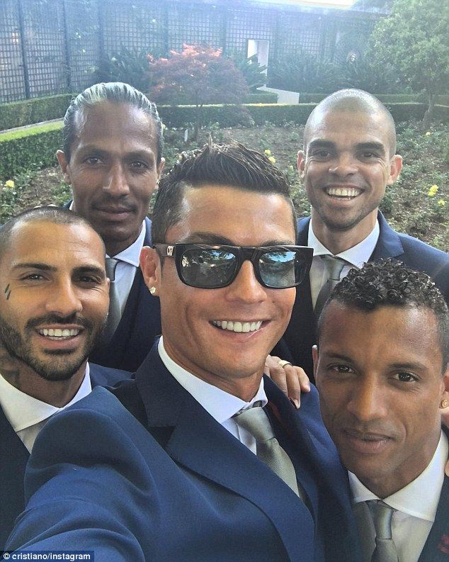 The Real Madrid star posed in the middle of (left-right) Raphael Guerreiro, Bruno Alves, P...