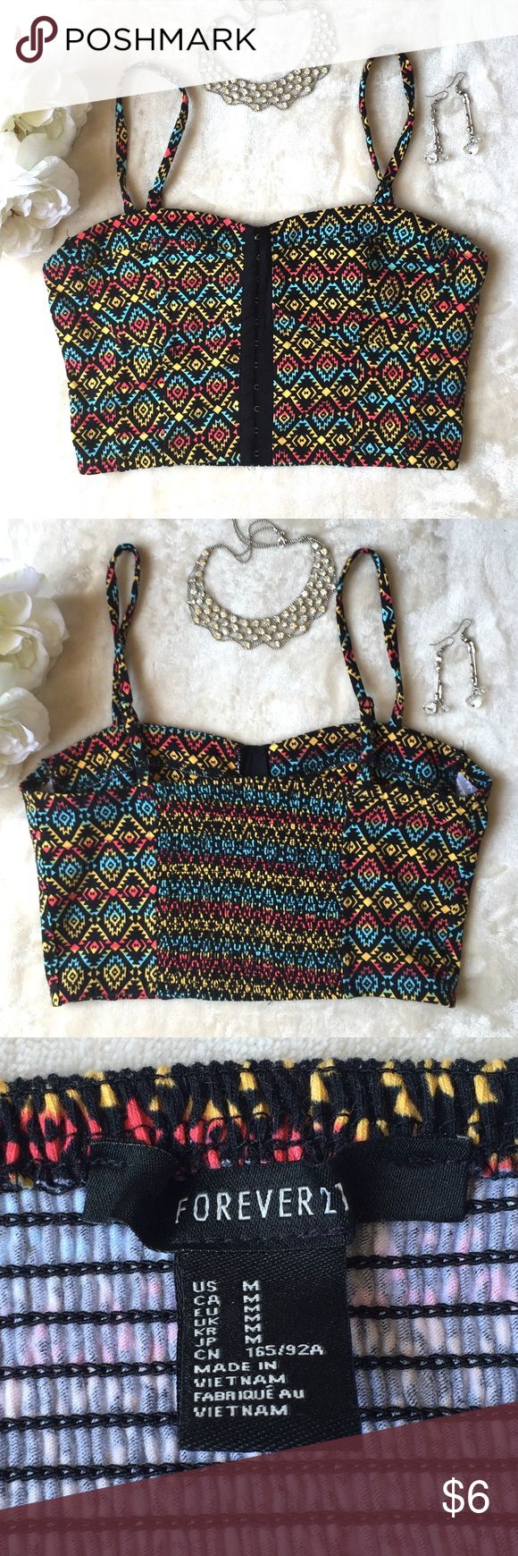 Forever 21 Aztec Print Bustier Crop Top Forever 21 Aztec print corset crop top with adjustable straps. Bustier hook front closure. Stretchy gathering in the back. In excellent used condition. Size medium. This is quite short and close to bandeau coverage. Forever 21 Tops Crop Tops