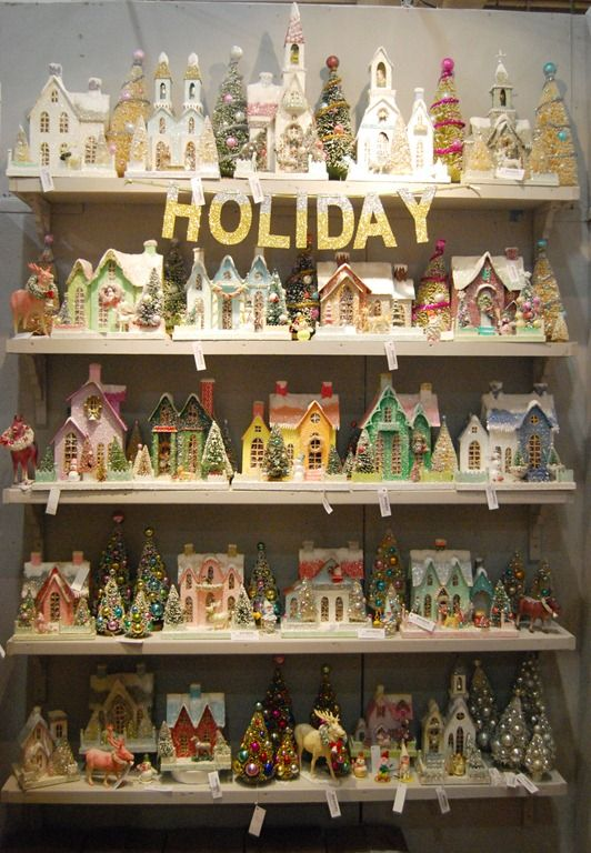 So cute to have a shelf full of colorful Christmas houses during the holidays...