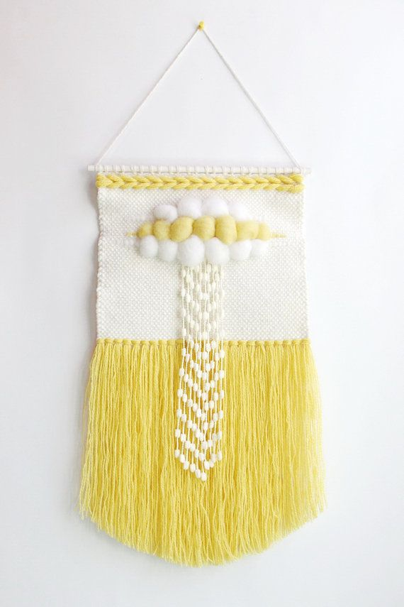 Woven wall art Sunny cloud will become pure highlight of your sweet home or work studio! NOTE: Your order will be shipped out shortly after 5th of August. Hand-woven with great care combining various weaving techniques to bring pure and light textures and look. Woven in ivory, creme, pale yellow and yellow colors using natural wool and blended yarn. Wall art is also a perfect gift for your beloved ones! Size: 11 x 21 (with tassels) / 28 cm x 54 cm. Ships ready to hang on hand-painted…