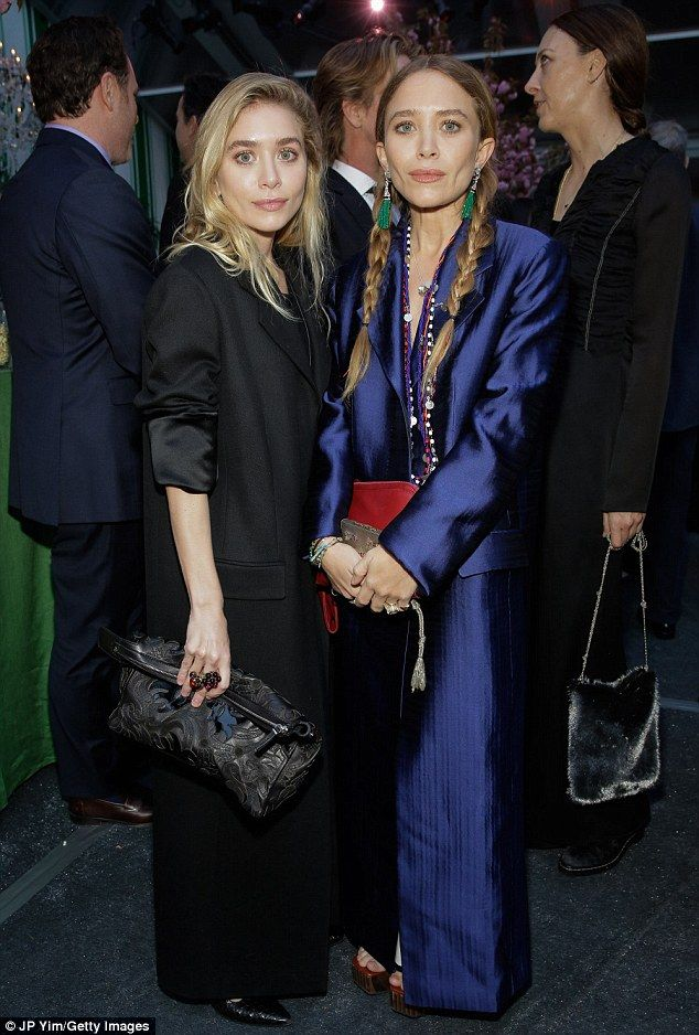 Twinning! Ashley and Mary-Kate Olsen donned wide-leg pantsuits, in black and vibrant blue, for the 40th anniversary Studio in a School bash in Manhattan on Wednesday
