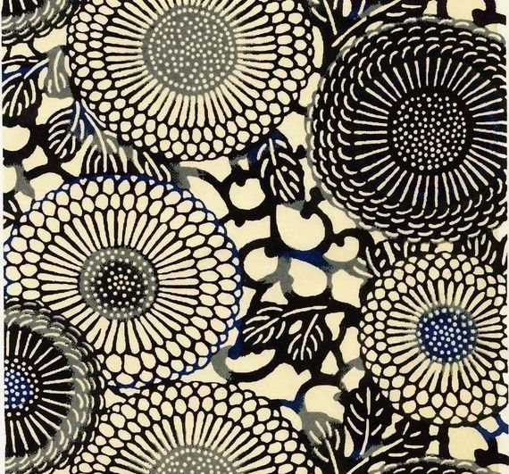 Chiyogami / dramatic black chrysanthemums with ultramarine blue accents on an ivory background.