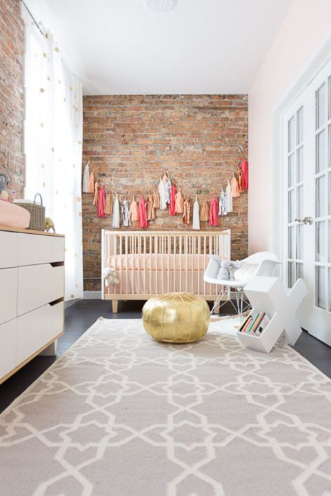 Tassel garland, a gold Moroccan pouf, and gold confetti curtainpanels set a festive tone. Via Grey Likes Baby