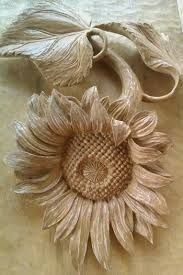 malaysian wood carving of sunflower