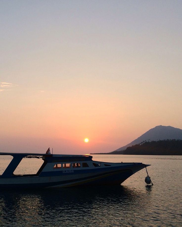 A see-you-again kiss from the sunset in Bunaken, North Sulawesi.