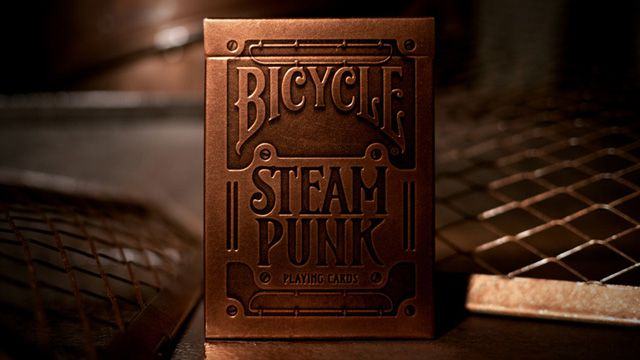 """""""Theory11's $6 Steampunk Playing Cards are manufactured in concert with the American Playing Card company on custom bronze-effect paper stock. The cards feature machinelike illustrations and are really rather well done."""""""