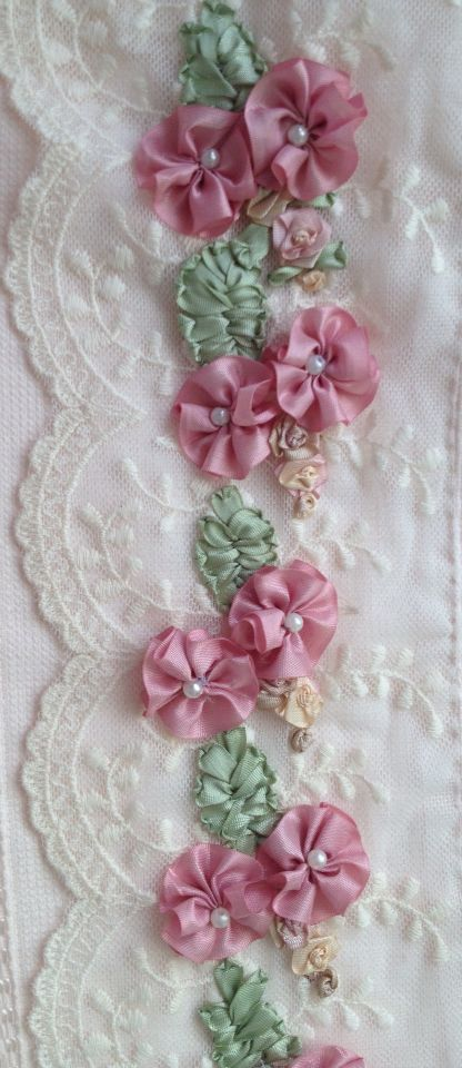 Ribbon flowers on lace fabric
