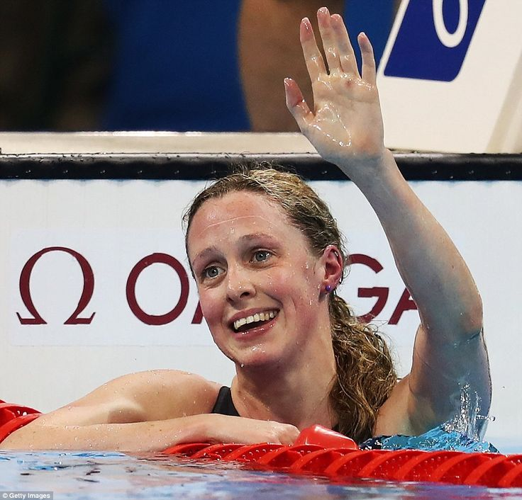 Hannah Miley of Great Britain waves to the crowd after she comes fourth