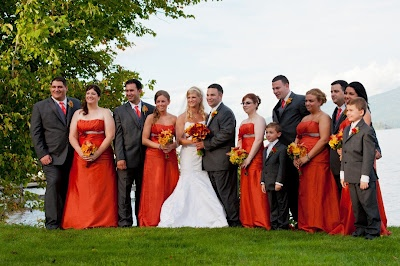 Bridal party colors of deep orange and grey.  Truet wedding, photo by Tom Wall Photography.