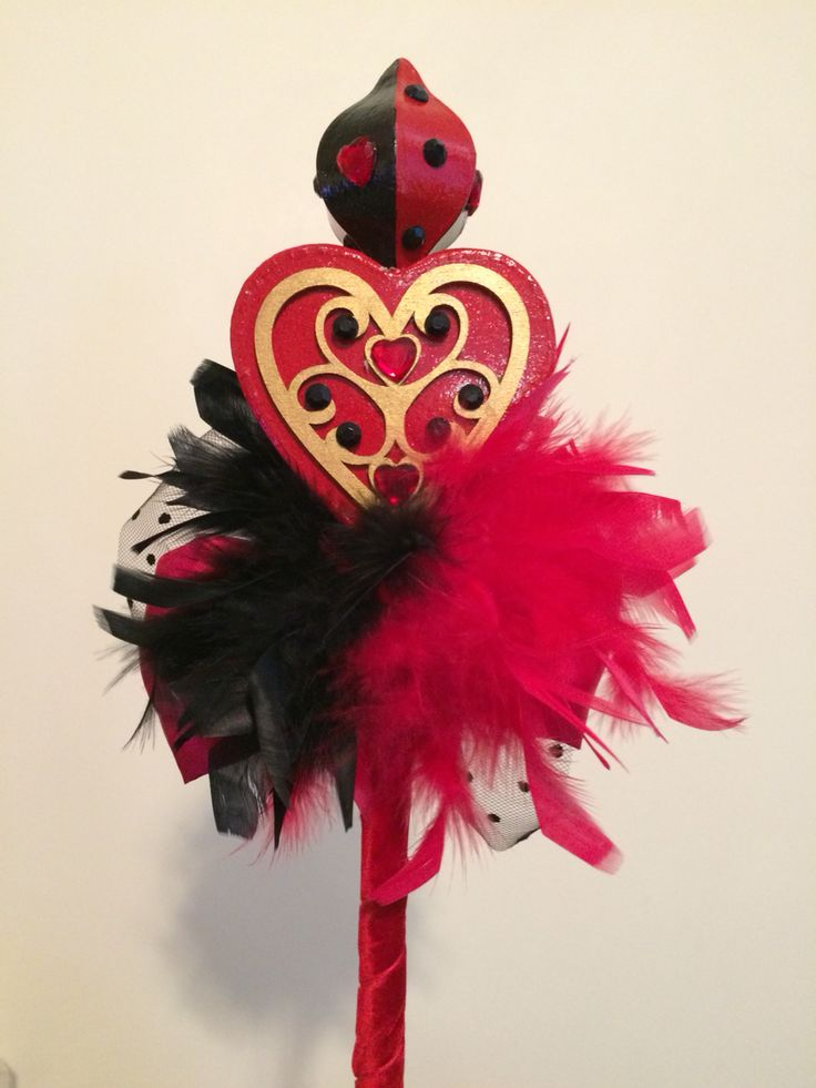 DIY Queen of Hearts scepter, made with 3D paper mâché hearts and a Christmas ornament from the craft store, painted with acrylic paint and bedazzled!