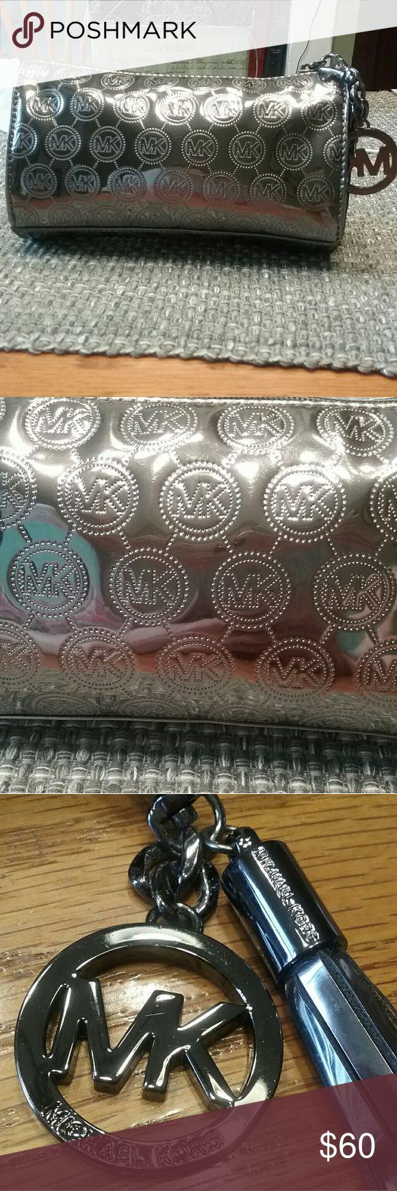 Michael kors silver metallic makeup bag brand new Brand new without tags Michael Kors Bags Cosmetic Bags & Cases