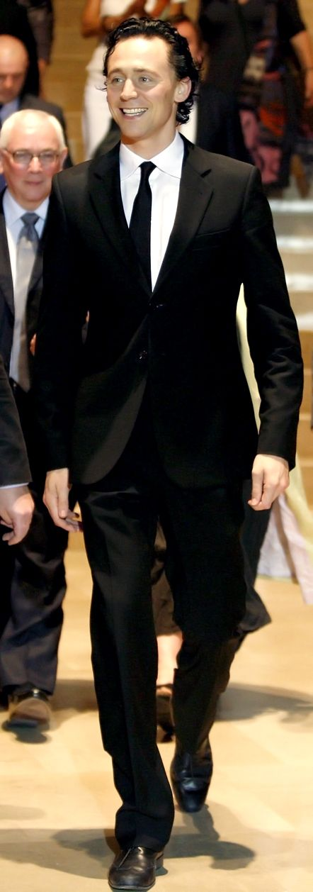 Tom looking dapper in that suit and tie. Likely from the Avengers? He has the Loki hair here.