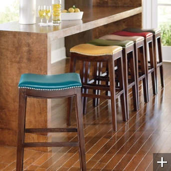 I bought different stools for the music room even though I loved these more.  The others are very nice, and half the price so it seemed to be a no brainer.  But still...I love this teal with the nail heads.