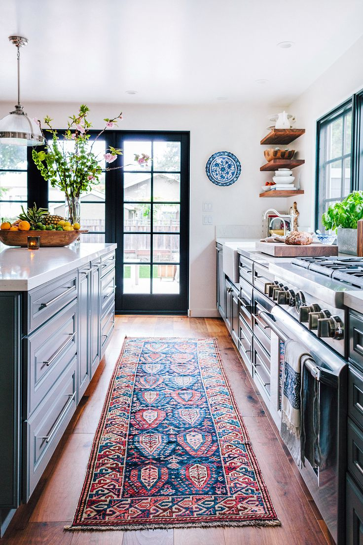 Honestly, I must have been a rug dealer in a past life. Or at least that's what I tell myself as the saga of rug hoarding continues in our household. My latest project? Our kitchen. I've been desperately searching for the perfect runner to enhance my favorite room in the house. And really, there's