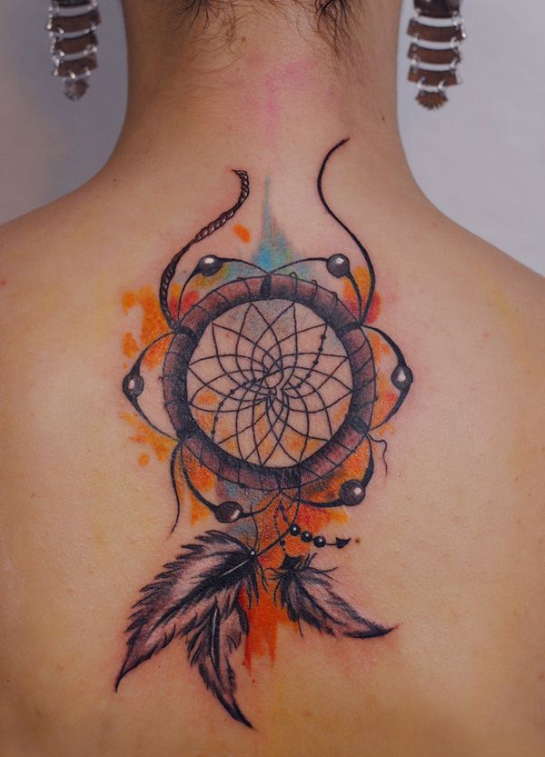 Booby dreamcatcher - I don't know what those booby look alike things around the dreamcatcher  for, but if you're a feminist, you could use this design. #TattooModels #tattoo