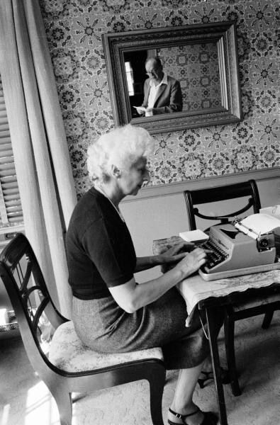 Vladimir Nabokov, reflected in mirror, dictating to his wife, Vera.