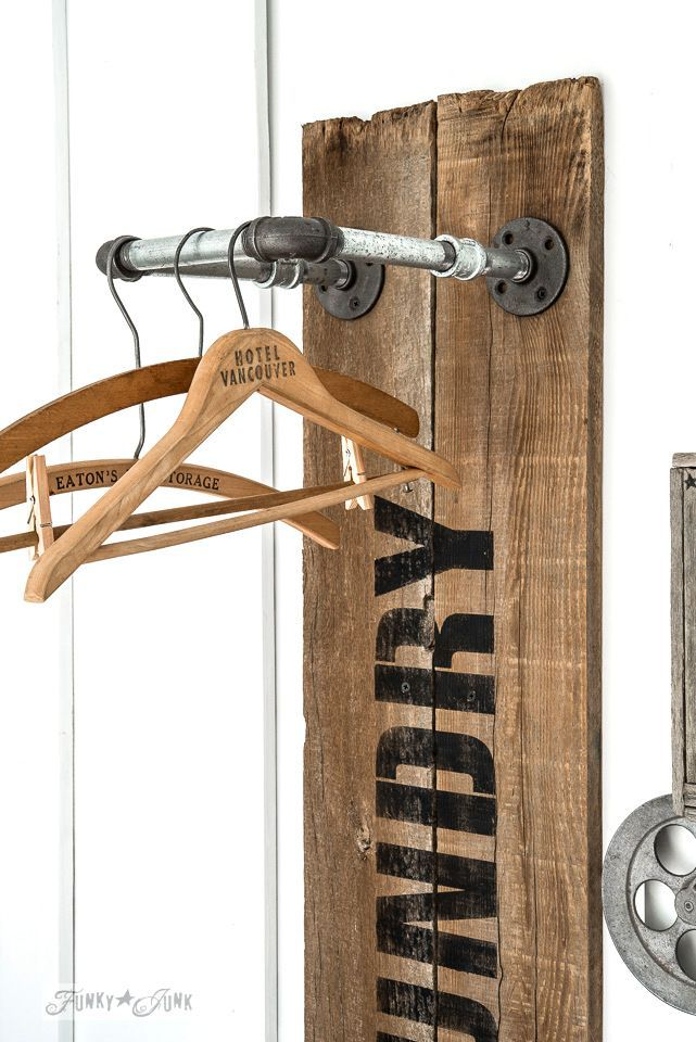 Using pipe fittings for hanging laundry on this industrial farmhouse reclaimed wood and pipe LAUNDRY sign hanging station, with Funky Junk's Old Sign Stencils and Fusion Mineral Paint | funkyjunkinteriors.net